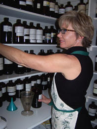 Susan and her bottle-stocked shelves