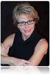 A headshot of Susan